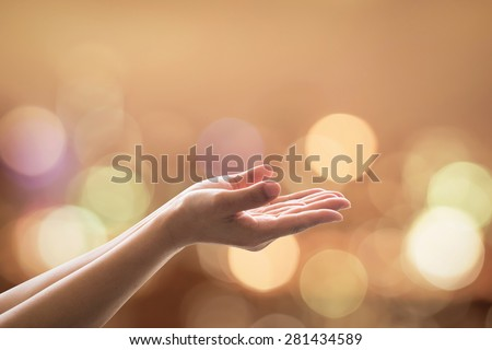 Empty female women open human hand prayer w/ palms up & candle night light natural warm gold lantern bokeh: Pray support aid destiny help peace campaign: Holy spirit: World religion day: Eid mubarak