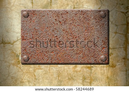 Empty ferruginous signboard on a concrete wall