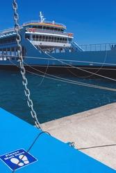 Empty ferry boat docked in port.