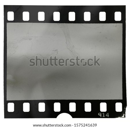 empty filmstrip on white background with dust and scratches