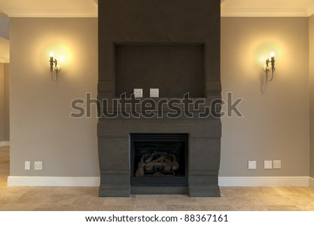 Empty fireplace and lounge inside a modern house