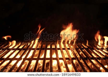 Empty Flaming BBQ Charcoal Grill. Hot Barbeque Grill Ready Cooking Food On Cast Iron Grate. Concept For Cookout, Barbecue Party At Garden Or Backyard. Grill With Bright Flames Black Isolated.