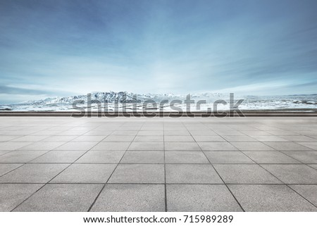 empty floor and beautiful snow mountains in blue sky