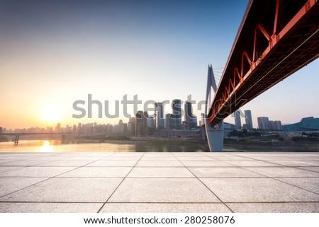 Empty floor in front of skyline and bridge #280258076