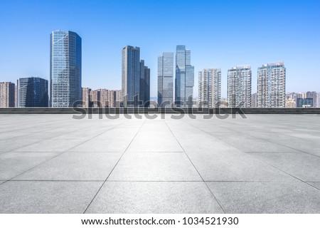 empty floor with modern building #1034521930