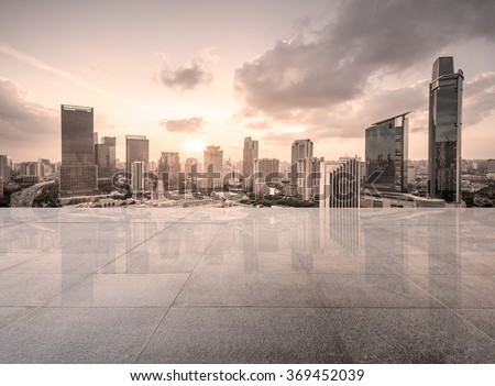 Empty floor with modern skyline and buildings #369452039