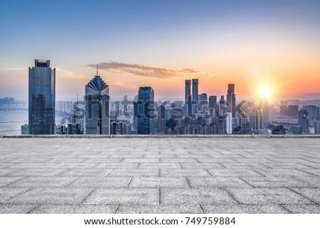 Empty floor with modern skyline and buildings #749759884