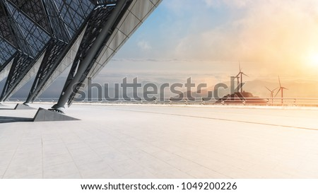 empty floor with wind farm and mountains in sunrise