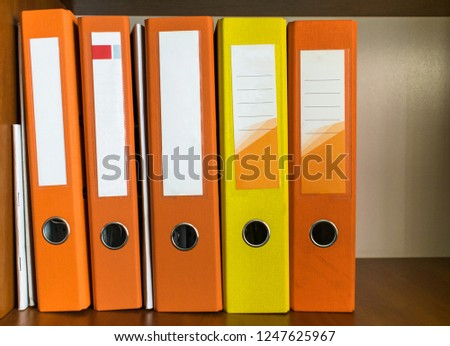 Empty folders with documents on the shelf #1247625967