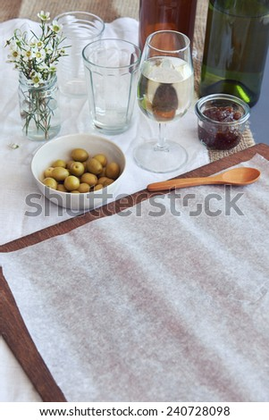 Empty food board as copy space with bottles of wine and olives