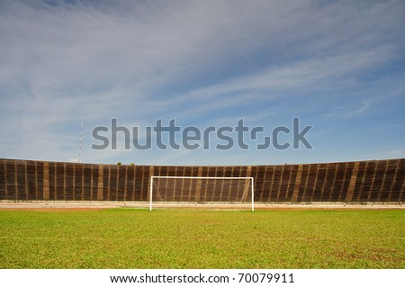 Empty football goal in empty stadium - stock photo