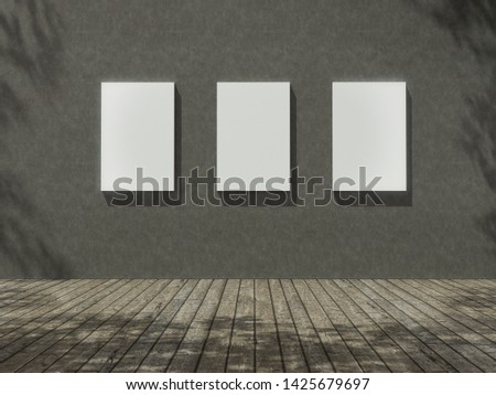 Empty frame in Empty room with Trees shadow on the wall .