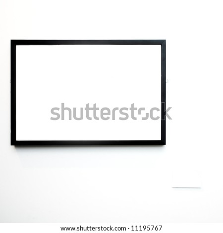 empty frame on white wall in museum