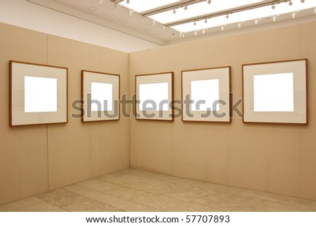 empty frames in a room against exhibition wall