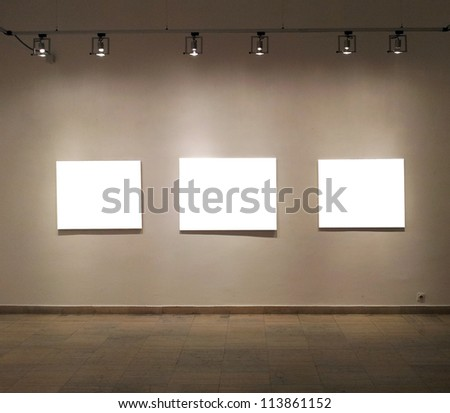 Empty frames in gallery room - stock photo