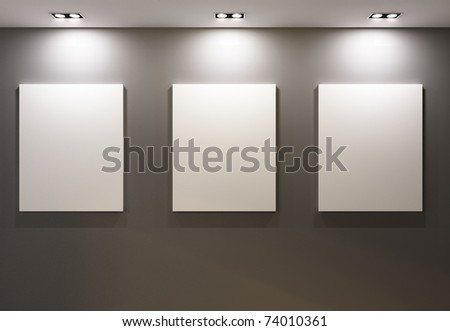 Empty frames on grey wall in gallery of  museum interior