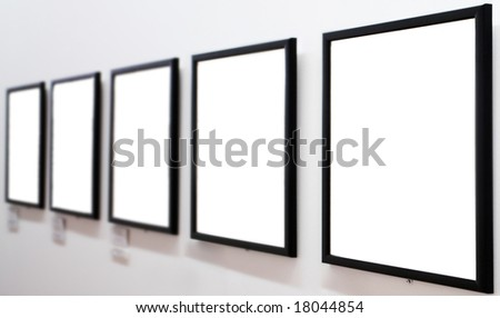 empty frames on white wall in museum - stock photo