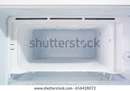 empty freezer of a refrigerator - Ice buildup on the inside of a freezer walls.  Stockfoto ©