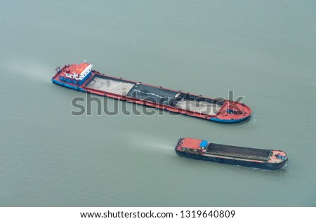 Empty freighter sailing on the Huangpu River #1319640809