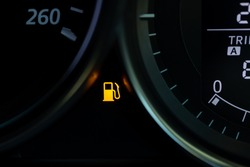 Empty fuel warning light in car dashboard. Fuel pump icon. gasoline gauge dash board in car with digital warning sign of run out of fuel turn on. Low level of fuel show on speedometer dashboard.