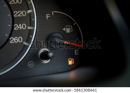 Empty fuel warning light in car dashboard. Fuel pump icon. gasoline gauge dash board in car with digital warning sign of run out of fuel turn on. Low level of fuel show on speedometer dashboard. ストックフォト ©
