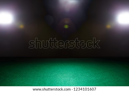 Empty gambling table in green colors. Light effect.