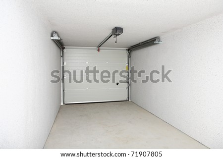 Empty garage or warehouse with closed door