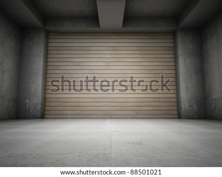 Empty garage with metallic roller shutter door