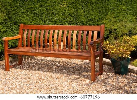 Empty garden bench in the sunshine