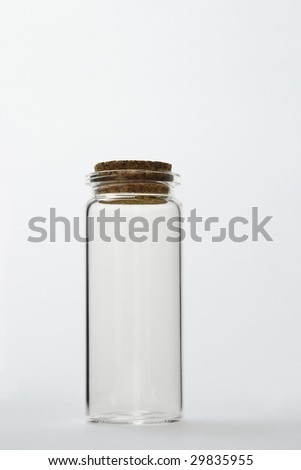 Empty glass bottle with cork stopper on seamless background with copy space