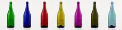 Empty glass bottles in different colors isolated on white background. Set, collection. Glass bottle for wine, champagne, mineral water blue, green, yellow, red and other different colors. Layout.