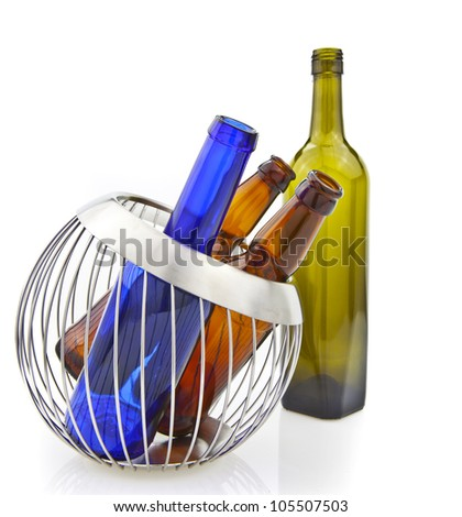 Empty glass bottles in wire basket isolated over the white background
