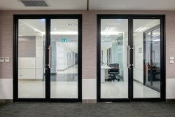 Empty glass door with black Aluminium frame in office building for wall backgroud