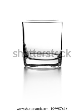 Empty glass for whiskey on white background