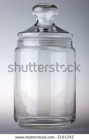 Empty glass jar on the gray background