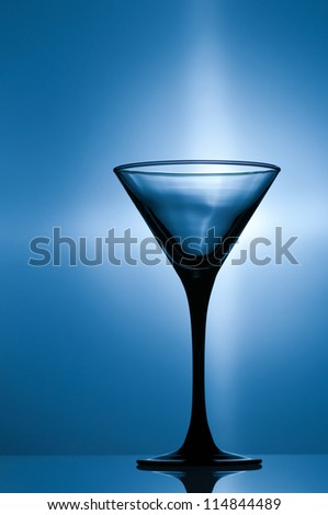 Empty glass on a monochromatic background