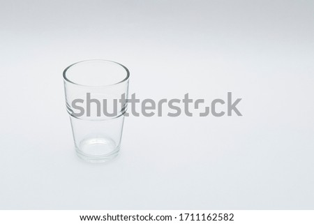 Empty   glass water on white background. Copy Space