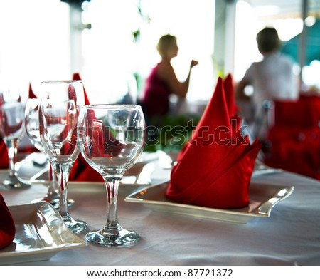 Empty glasses on table in restaurant