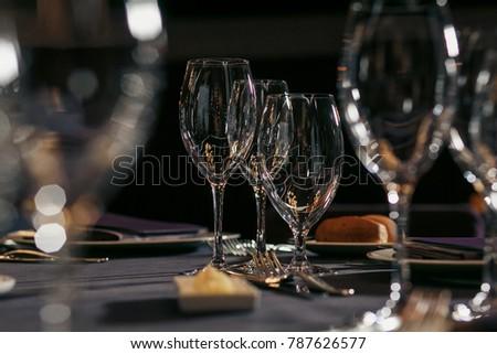 Shutterstock Empty glasses set in restaurant