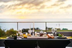 Empty glasses set in restaurant - Dinner table outdoors at sunset