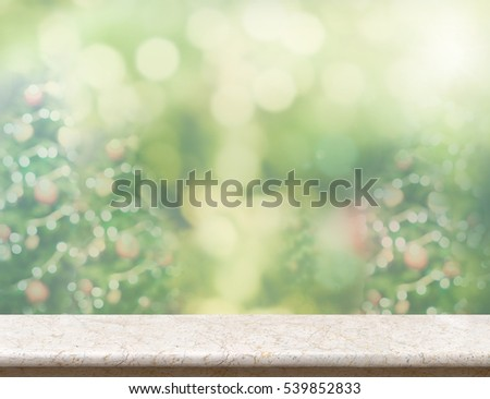 Empty glossy marble table with blur Christmas tree green background,Holiday display backdrop design,Mock up to display or montage of product #539852833