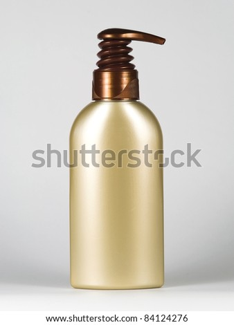 empty gold-brown cosmetic bottle