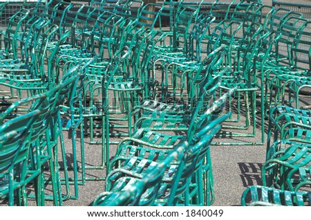 Empty green chairs in the park