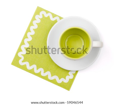 Empty green cup on green placemat. Above view. Isolated on white background