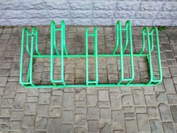 Empty green parking space for bicycles in front of the store. Bicycle parking in a public area. Empty bicycle parking lot on the street.