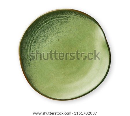 Empty green plate with wavy edge, Frilled plate in wavy pattern, View from above isolated on white background with clipping path