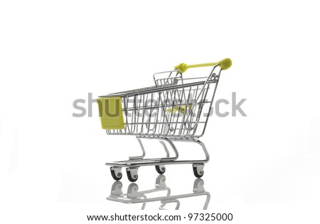 Empty green shopping cart isolated on white background with refl