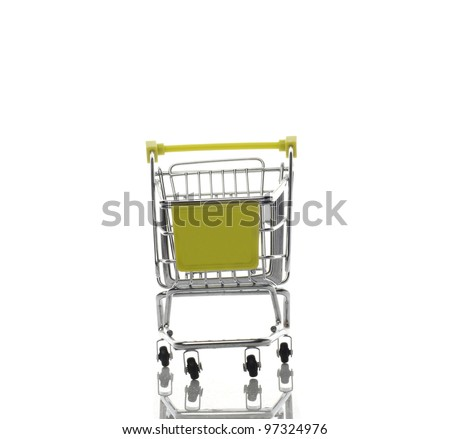 Empty green shopping cart isolated on white background with reflection in front view