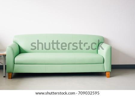 Empty green sofa on white background.Interior modern living room. #709032595