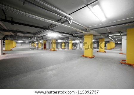empty grey parking with colored elements without cars